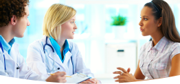 customer consulting with two pharmacists