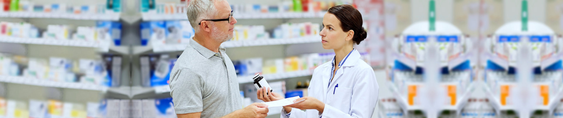 elderly customer consulting pharmacist with his medication