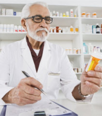 pharmacist looking at a bottle of medicine