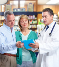couple consulting to a pharmacist