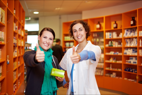 customer and pharmacist showing thumbs up